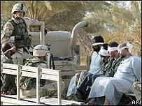 US soldiers arresting Iraqis in Tikrit