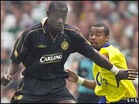 Momo Sylla holds off a challenge from Arsenal's Ashley Cole
