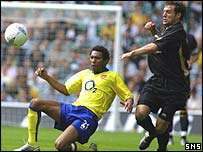 Jermaine Pennant takes the ball from Celtic's Jamie Smith