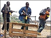 Loyalist combatants move into position in a failed attempt to recapture the strategic Old Bridge in the centre of Monrovia