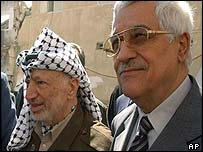 Palestinian leader Yasser Arafat [left] with Palestinian Prime Minister Mahmoud Abbas