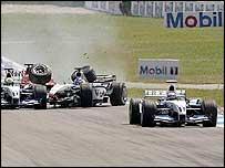 Montoya escapes the first-corner carnage between Ralf Schumacher, Rubens Barrichello and Kimi Raikkonen
