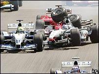Ralf Schumacher (left), Rubens Barrichello (hidden) and Kimi Raikkonen collide at the start of the German Grand Prix