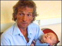 David Putt holds his grandson Rhys