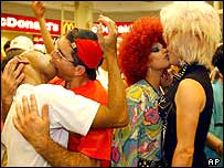 Gay couples kiss inside a mall in Sao Paulo, Brazil