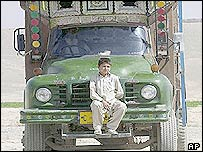 Boy riding a truck on an Afghan motorway