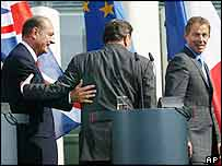 President Chirac and Chancellor Schroeder arm in arm after a summit with Tony Blair