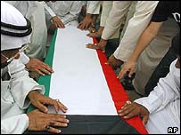 Relatives touch the coffin of a Kuwait POW whose remains were found in a mass grave in southern Iraq