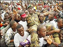 Nigerian officer being carried by jubilant Liberians