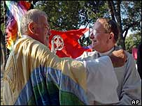 James Jelinek (L), Episcopal Bishop of Minnesota, embraces Canon Robinson