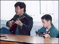Kazakhstan's culture minister Blekpolat Tleukhan with school child (Pic: Michael Church)