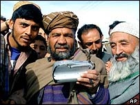 People listen to the radio in Afghanistan