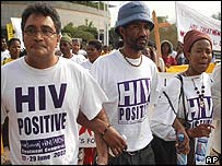 Zackie Achmat (left) and other protesters march on the Durban Aids forum
