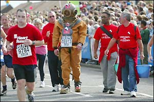 Lloyd Scott takes part in the race dressed in a deep sea diver's outfit