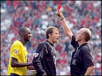 Ref Bennett shows the red card to Patrick Vieira
