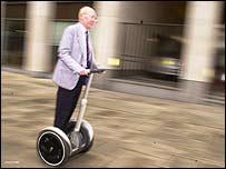 Sir Clive Sinclair rides a Segway