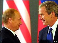 Russian President Vladimir Putin and US President George W Bush shake hands and exchange treaties