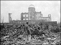 Man standing in the ruins of the Japanese city of Hiroshima after an atomic bomb was dropped on it