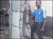 David Kigozi with a sample of a baobab metal sculpture