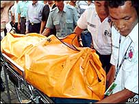 Medical staff carry the body of a victim from the blast