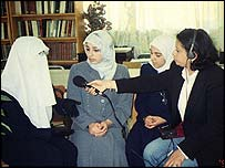 Safa Faisal interviewing girls in a class in Jordan