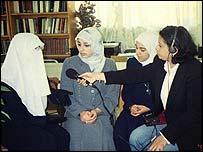 Safa Faisal interviewing girls in a class in Jordan