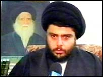 Moqtada Sadr with portrait of his father