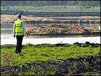 Official near artificial lake in Whitchurch, Hampshire, where a teenager died