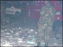 Soldiers inspects riot debris