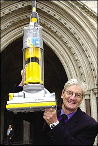 James Dyson with one of his vacuum cleaners