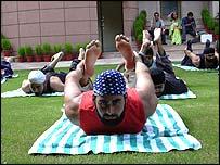 Models practising yoga