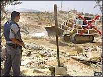 Soldier at fence site