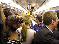 Commuters on a packed underground train