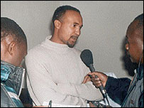 Zein Dudah (centre) speaking to journalists