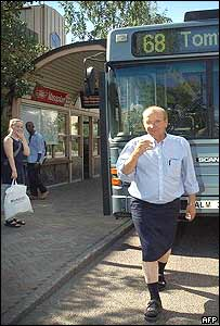Bus driver Mats Lundgren walks in front of his bus, dressed in skirt, in Umea, northern Sweden