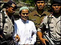 Amrozi is escorted from court, 6 August 2003