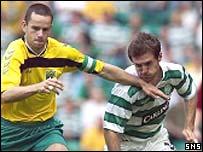 Tomas Kancelskis holds off Celtic's Jamie Smith