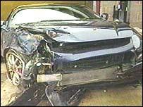 The crashed Maserati sports car
