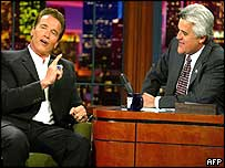 Actor Arnold Schwarzenegger [l] speaks to host Jay Leno during taping of the Tonight Show