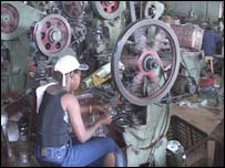 Nigerian working in a factory