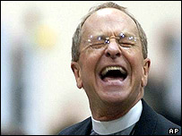 Bishop-elect Reverend Gene Robinson of New Hampshire listens to debate on blessing same sex unions