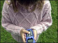 Girl using mobile phone, BBC
