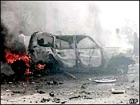 Blazing car after bomb attack
