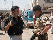 Fergal Keane with a British soldier (picture by Christian Fraser)