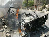 Burned-out jeep in Baghdad