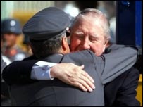 Pinochet is hugged by a supporter on his return to Chile