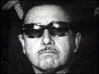 Pinochet, in sunglasses, assumes power in 1973