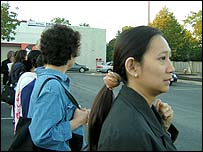 Demile Nguyen waits for a car going her way