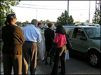 'Slugs' queue for their free lifts to work in Springfield, Virginia