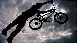 A dirt jumper flies through the air in spectacular fashion